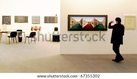 MILAN - MARCH 27: People look at painting galleries during MiArt ArtNow, international exhibition of modern and contemporary art March 27, 2010 in Milan, Italy.