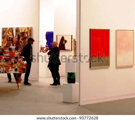 MILAN - MARCH 27:People look at work of arts in exhibition at MiArt ArtNow, international exhibition of modern and contemporary art March 27, 2010 in Milan, Italy.