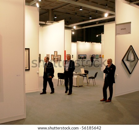 MILAN - MARCH 27: People look at works of art during MiArt ArtNow, international exhibition of modern and contemporary art March 27, 2010 in Milan, Italy.