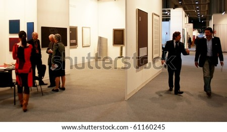 MILAN - MARCH 27: People look at works of modern art during MiArt ArtNow, international exhibition of modern and contemporary art March 27, 2010 in Milan, Italy.
