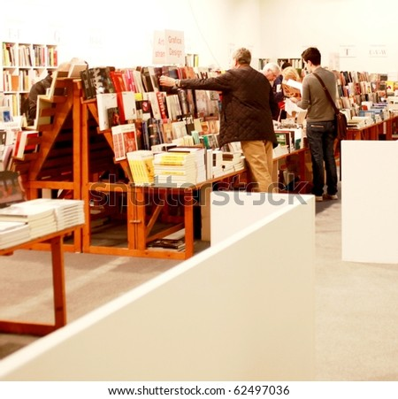 MILAN - MARCH 27: People look for art books at MiArt ArtNow, international exhibition of modern and contemporary art March 27, 2010 in Milan, Italy.