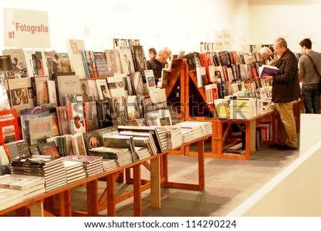 MILAN - MARCH 27: People look for arts books at MiArt ArtNow, international exhibition of modern and contemporary art March 27, 2010 in Milan, Italy.