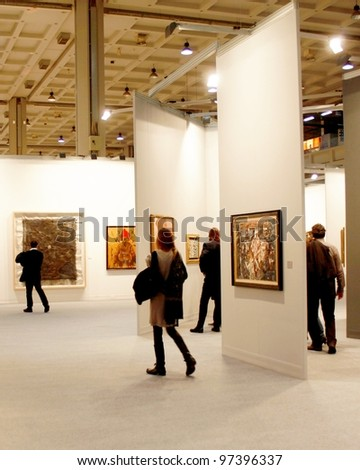 MILAN - MARCH 27: People walk trough paintings work of arts galleries during MiArt ArtNow, international exhibition of modern and contemporary art March 27, 2010 in Milan, Italy.