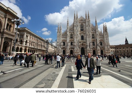 MILAN - MAY 8: Tourists visit Piazza Duomo on May 8, 2010 in Milan, Italy. As of 2006, Milan was the 42nd most visited city worldwide, with 1.9 million annual international visitors