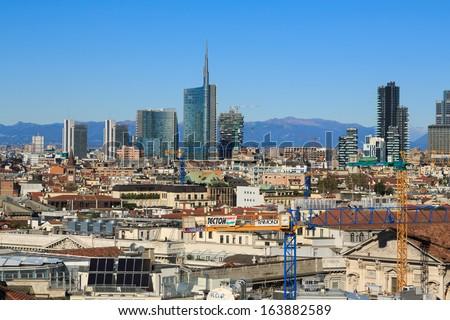 MILAN - NOVEMBER 12: View of Milan modern skyline growing from Duomo at Piazza Duomo , Milan, Italy in November 12, 2013.