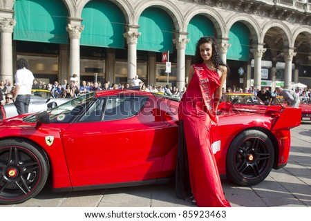 MILAN - OCTOBER 2011: An unidentified model poses beside a Ferrari Enzo at the Ferrari Club of Milan Annual meeting on October 2, 2011 in Milan, Italy.