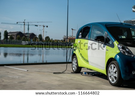 MILAN - OCTOBER 03: Electric vehicle in car sharing station. This innovative service allows to pick up and deposit cars in various parking areas around the city, on October 03,2012 in Milan, Italy