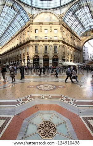 MILAN - OCTOBER 6: People visit Vittorio Emmanuele II shopping gallery on October 6, 2010 in Milan, Italy. Inaugurated in 1865, the gallery claims to be the oldest shopping center worldwide.