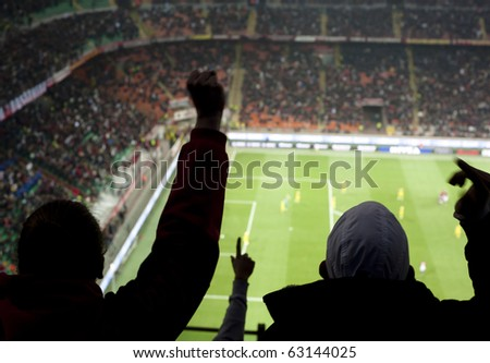 MILAN-OCTOBER 16: Supporters cheer their team after a goal at Italian Championship soccer game, AC Milan - Chievo on October 16, 2010 in Milan
