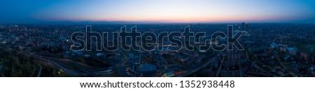 Milan panoramic skyline at dawn, aerial view.
