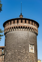 Milan. Sforza Castle (Castello Sforzesco, 15th century). Detail of the Tower of the Holy Spirit (Torrione di Santo Spirito) with emblem of Sforza Family. Milan, Lombardy, Italy, Europe.