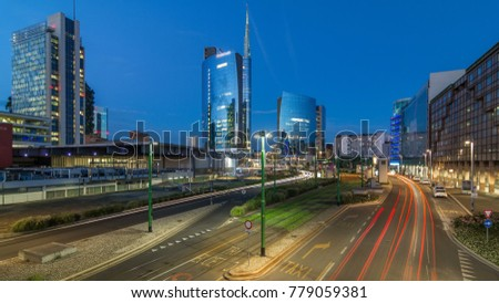 Milan skyline with modern skyscrapers in Porta Nuova business district day to night transition timelapse in Milan, Italy, after sunset. Traffic on the road. Light in windows. Top view from bridge #779059381