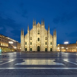Milano Duomo Cathedral and Vittorio Emanuele II Gallery. Illuminated buildings on Piazza del Duomo at night. Romantic architecture of Italy, Milan in the evening. Selective focus.
