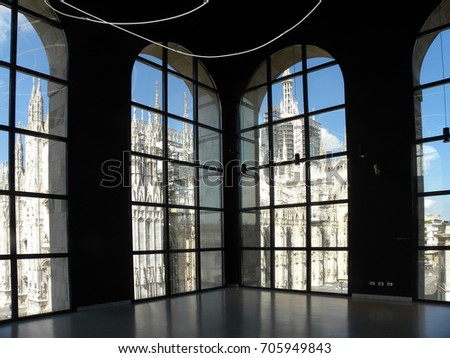 MILANO, ITALY - JULY 14, 2017: Museo del Novecento, museum of XX century art, housed in the Palazzo dell'Arengario, near Piazza del Duomo. Opened in December 2010, it displays about 400 works. #705949843