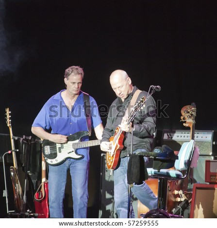 "MILANO, ITALY - JULY 14: Singer and guitarist Mark Knopfler on stage of his own concert for ""Milano Jazzin Festival"", on July 13, 2010 at Arena civica of Milan, Italy"