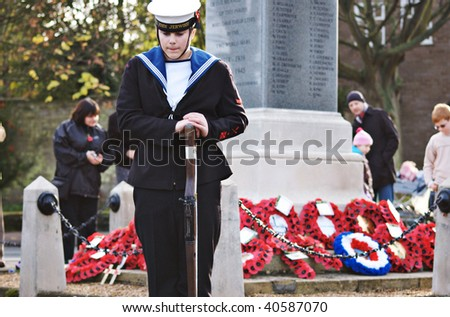 MILDENHALL, UK - NOVEMBER 8: Royal Navy Sea Cadet standing guard at the war memorial during the remembrance sunday parade and ceremony on November 8, 2009 in Mildenhall, UK.