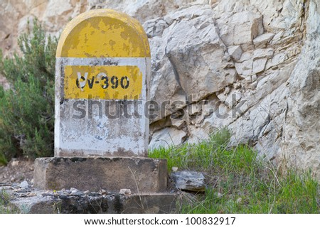 Milestone along an old road in the mountains