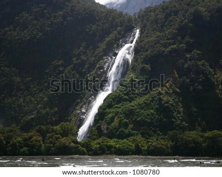 Milford Sound Waterfall - stock photo