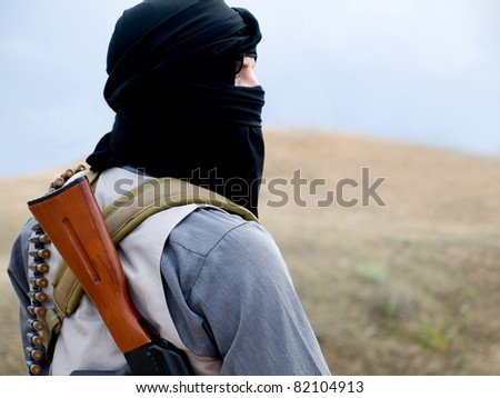 militant with rifle - stock photo