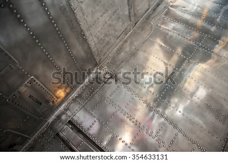 military aircraft close up of outer silver body and rivets #354633131