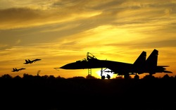 Military aircrafts silhouettes  on sunset background