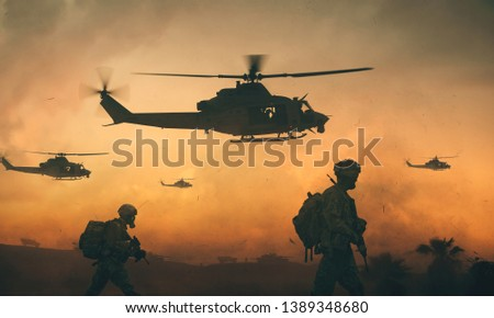 Military and helicopter troops on the way to the battlefield in sunset.