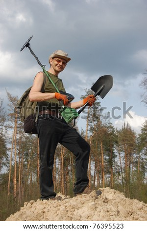 Military archeology. Man with metal detector on the battlefield of WW2.Near Kiev,Ukraine - stock photo