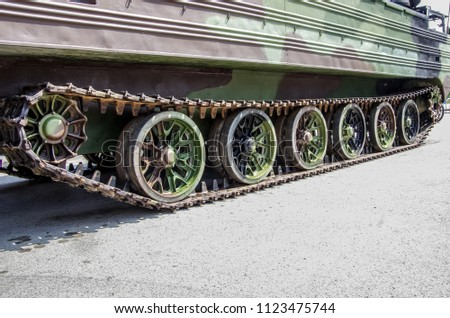 Military armored vehicle, tracks from the vehicle. #1123475744