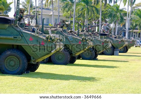 Military Army Stryker light armored brigade vehicle in a row