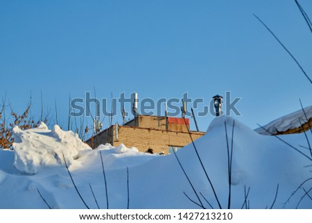 Military building in winter located in the snow drifts. Whige landscape #1427213210