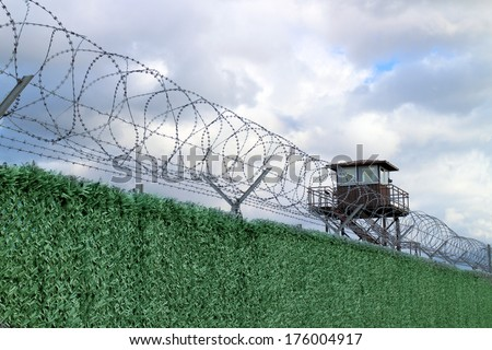 Military camp with fence and watchtower