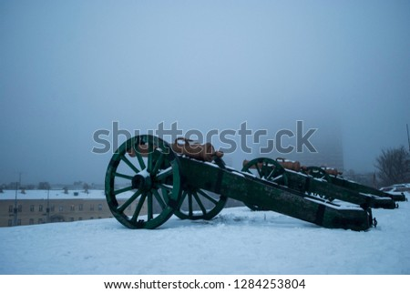 Military cannon, middle ages, old weapons.Winter snow. Fortress, war. Vintage machine gun . Cannons - Image #1284253804