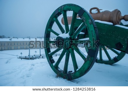 Military cannon, middle ages, old weapons.Winter snow. Fortress, war. Vintage machine gun . Cannons - Image #1284253816