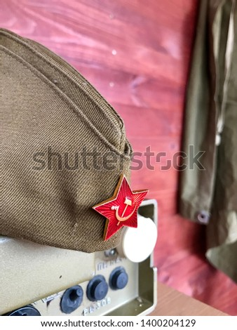 Military cap with badge. Military cap with badge.