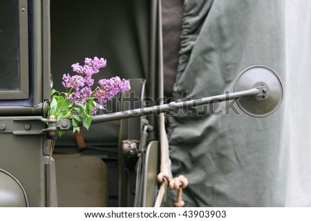 military car and lilacs