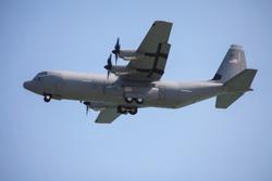 military cargo plane in landing
