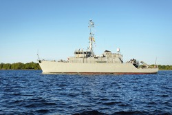 Military coast guard patrol ship close-up. Riga bay, Baltic sea, Latvia. Industry, warship, freight transportation, politics, international security and global communications