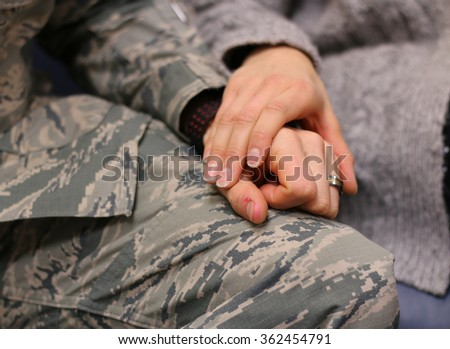 Military couple holding hands, married caucasian, Air Force.