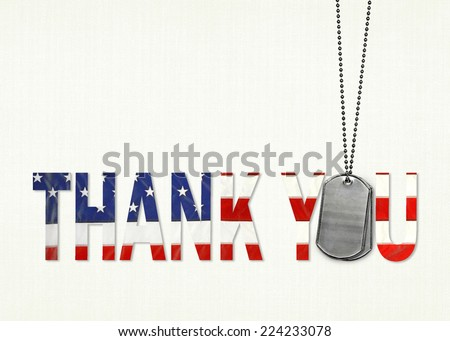 military dog tags with flag thank you on textured background