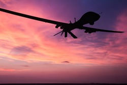 Military drone silhouette  on sunset background.
