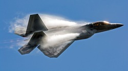 Military F22 fighter jet flying