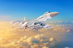Military fighter aircraft at high speed, flying high in the sky sunset