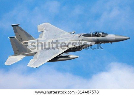 Military fighter aircraft flying
