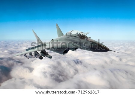 Military fighter jet flies in the sky above the clouds #712962817