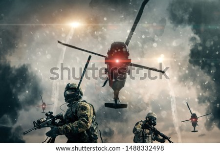 Military forces and helicopters between smoke and dust in battlefield