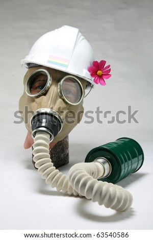 """military gas mask on a 1930's era manniquen head with a pink flower, represents the current """"United States Military"""" """"Don't Ask, Dont Tell"""" policy to keep gays out of the military concept"""