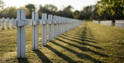 military graveyard with white crosses