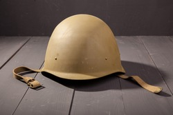 Military green helmet on the table