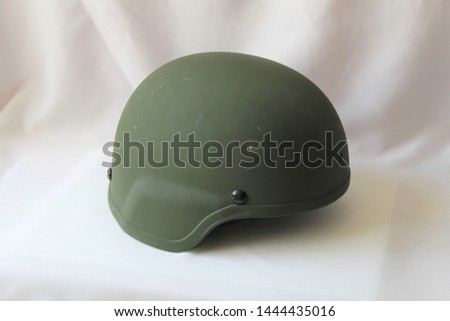 Military green soldier`s helmet on a white background. Solid army green Kevlar helmet. #1444435016