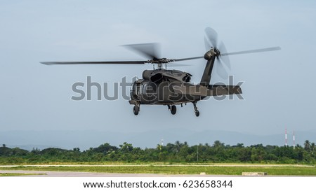 Military helicopter blackhawk at a base , Military helicopter landing